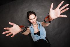 Arrest. criminal woman prisoner showing handcuffs Stock Photos