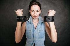 arrest. criminal woman prisoner showing handcuffs - stock photo