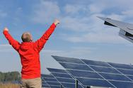 Stock Photo of Male solar panel engineer at work place