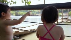 Little Kids Watch Boats At A Marina, Boy Points To Boat, Sister Looks Stock Footage