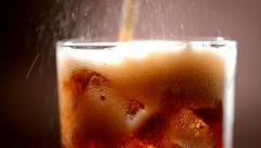 Cola with ice and bubbles in glass. Slow motion 240 fps. Full HD 1080p - stock footage
