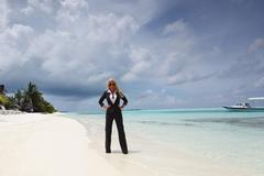 Stock Photo of happy business woman on the ocean coast