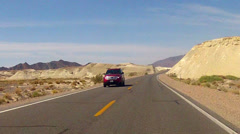 POV Car Driving Winding Road In SW Nevada Desert Stock Footage