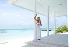 tropic woman on the veranda - stock photo