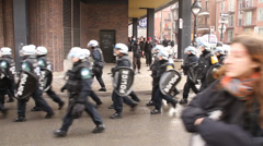 Tear gas bombs detonate while officers push rioters away Stock Footage