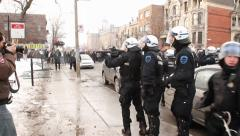 Riot officer fires 2 rubber balls during riot Stock Footage