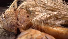 Various Bread and Sheaf of Wheat Ears. Slow Motion 240 fps. Full HD 1080p Stock Footage