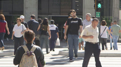 Sao Paulo Crowded pedestrian crossing clears, skate boarder thro' shot Stock Footage