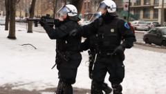 Riot unit gets snow balls thrown at them - HD 1080p Stock Footage