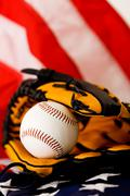 Stock Photo of baseball: ball in glove on flag