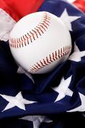Stock Photo of baseball: ball sitting on american flag