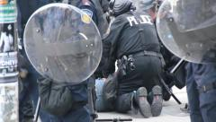 Riot police arrest man in large numbers - HD 1080p - stock footage