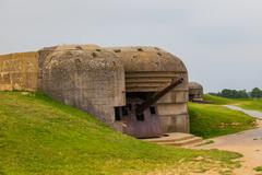 old broken german bunkers of atlantic wall and artillery battery of longues s - stock photo
