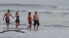 Costa Rica, Esterillos Beach, Two couples walking on beach Stock Footage