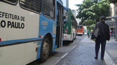 Sao Paulo Woman boards bus and departs Stock Footage