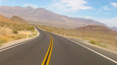 POV Car Driving Road Descending Into Desert Valley- SW Nevada Stock Footage