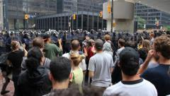 Demonstrators chanting at police line in city core - HD 1080p Stock Footage
