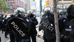 Riot officers in heavy gear closeup - HD 1080p Stock Footage
