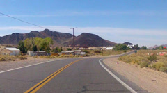 POV Driving Car Through Small Desert Town- Shoshone CA Stock Footage