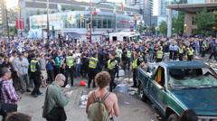 Man flees police in rioting crowd - HD 1080p Stock Footage