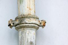 rusted clamped join in metal sewerage pipe - stock photo