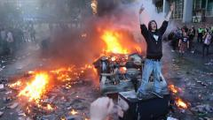 Man giving the finger with fire and tear gas bombs Stock Footage