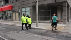 Police officers catch demonstrators with illegal projectiles Stock Footage