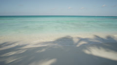 Grand Cayman, Sand beach with palm tree shade Stock Footage