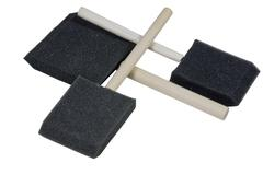 three crossed over wooden handled sponge applicators - stock photo