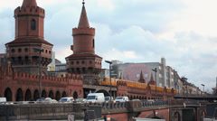 Berlin - Ubahn goes over Oberbaumbrückeb with blu mural in the background Stock Footage
