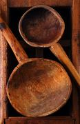 Retro kitchen utensils  wood spoon on old wooden box in rustic s Stock Photos