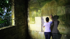 Female archaeologist studying hieroglyphs Stock Footage