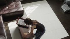 WS HA Woman cleaning room / Salt Lake City, Utah, USA Stock Footage