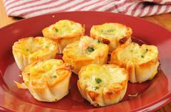 Mini quiche with bacon bits Stock Photos