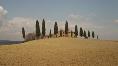 Wide shot/pan up of Italian farmhouse in countryside / Piensa, Tuscany, Italy - stock footage