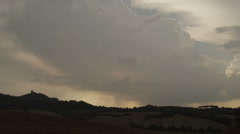 Time lapse/wide shot of storm clouds over hillside silhouette / Piensa, Tuscany Stock Footage