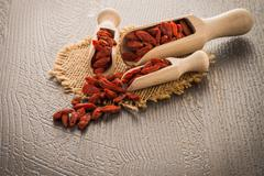 Goji berries on a wooden spoons Stock Photos