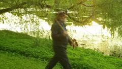 Coal miner walking by lake kentucky ky Stock Footage