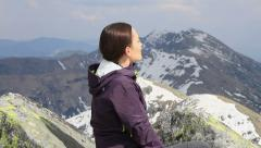 Beautiful woman takes a sunbath in the mountains HD Stock Footage