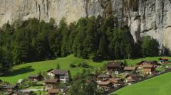 Wide shot of remote village in mountain valley / Lauterbrunnan, Switzerland Stock Footage