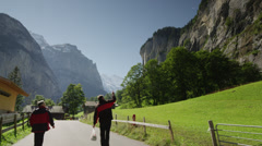 Medium snot of road leading to remote town / Lauterbrunnan, Switzerland Stock Footage