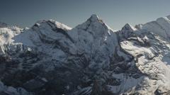Wide shot of snow covered mountain / Schilthorn Piz Gloria, Bern, Switzerland Stock Footage