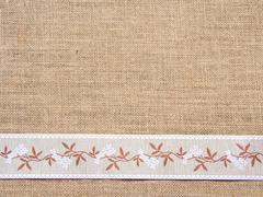 Burlap background with ribbon Stock Photos