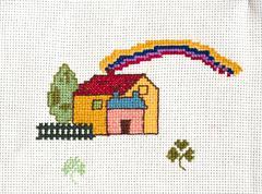 Cross-stitched house - stock photo