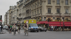 Slow motion/medium shot of traffic on city street / Paris, France - stock footage