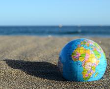 Globe earth on the beach Kuvituskuvat