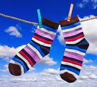 Stock Photo of colorful socks hanging on clothespins