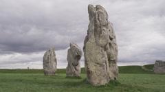 Medium shot of ancient stones in formation / Avebury, England, United Kingdom Stock Footage