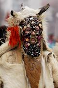 man in traditional masquerade costume - stock photo