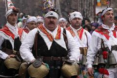 men in traditional masquerade costume - stock photo
